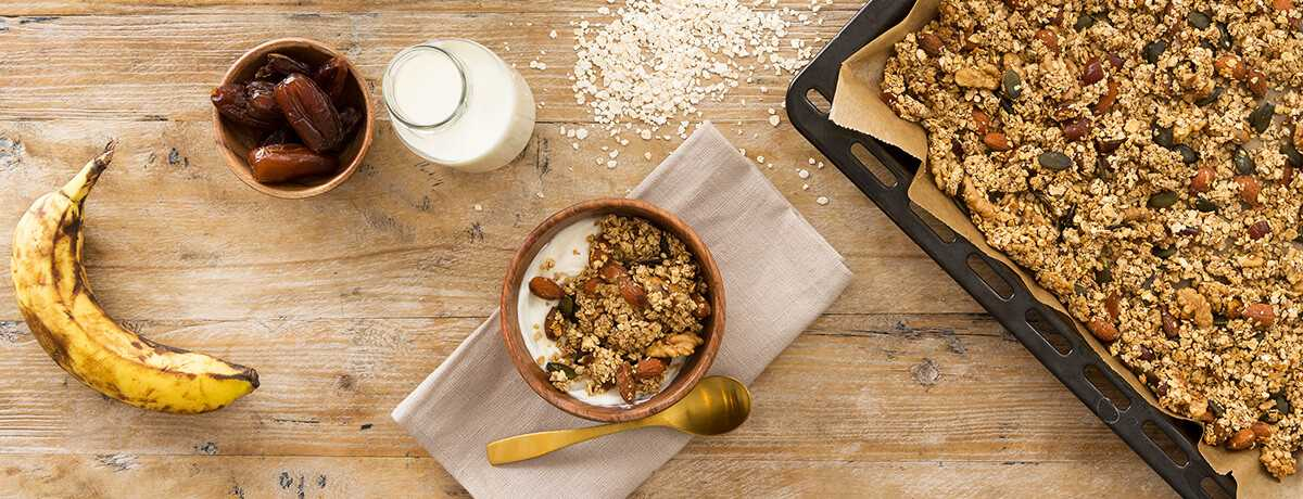 A baking tray spread with golden-brown banana protein muesli